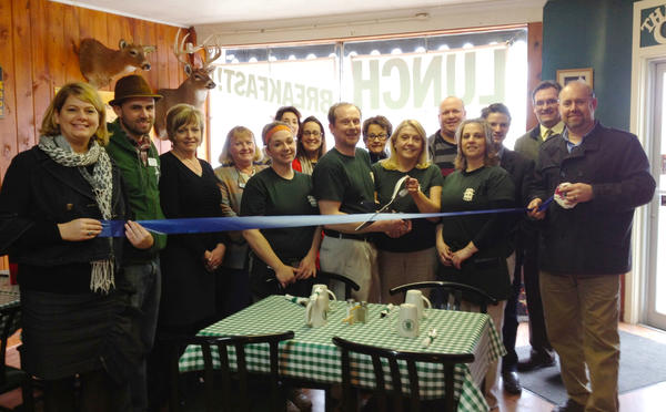 Petoskey Regional Chamber of Commerce ambassadors attended the recent ribbon-cutting with the employees of R&R's Cabin in Alanson.
