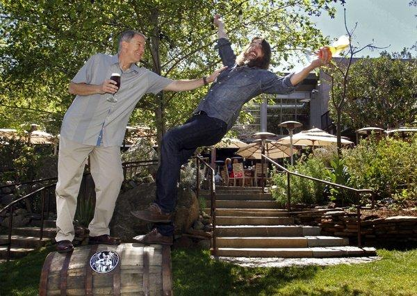 Steve Wagner, left, and Greg Koch are co-founders of Stone Brewing Co. in Escondido.