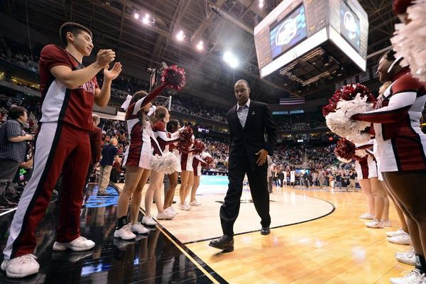 Harvard Coach Tommy Amaker walks off the court after losing to the Arizona Wildcats, 74-51, in the third round of the NCAA Tournament.