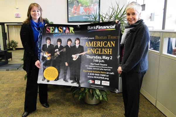 Jennifer Schinke (left), assistant vice president and branch manager of Bank Financial in Downers Grove, and Lisa Rasin (right), fund development coordinator for SEASPAR, hold a banner for a fundraiser event in May.