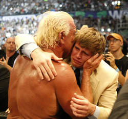 Ric Flair kisses his son, Reid, after Ric's retirement match at WrestleMania 24 in 2008.