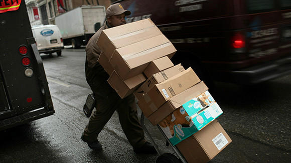 A United Parcel Services Inc. (UPS) worker delivers boxes on February 1, 2011 in New York City.
