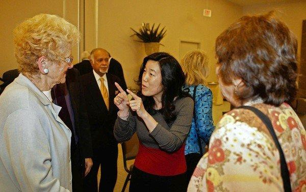 Michelle Rhee, center, former Chancellor, Washington DC Public Schools, answers questions after delivering a speech.
