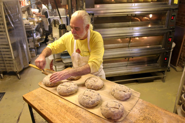 Niles Golovin prepares loaves of olive bread for baking at Bantam Bread Company in Bantam.