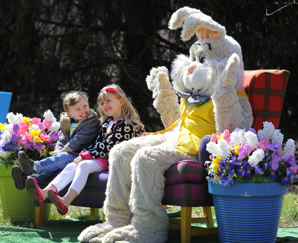 Logan Snyder, 3 and his sister, Kaitlyn Snyder, 6, of Forest Hill have their picture taken with the Easter Bunny at Bunny BonanZOO. Bunny BonanZOO at the Maryland Zoo.