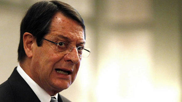 Cyprus' President Nicos Anastasiades addresses a conference of civil servants in Nicosia Friday.