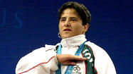 Soraya Jimenez, who won the 58-kilogram weightlifting competition at the 2000 Sydney Games to become Mexico's first female Olympic champion, died of a heart attack Thursday at her home in Mexico City. She was 35.