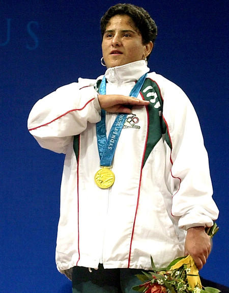 Weightlifter Soraya Jimenez salutes from the victory stand as the national anthem of Mexico plays after she received her gold medal at the 2000 Sydney Olympics.