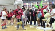 "Lincoln County Middle School teachers and staff took advantage of a timeout during a basketball game Friday to surprise students and other staff with a rendition of the popular ""Harlem Shake"" meme."