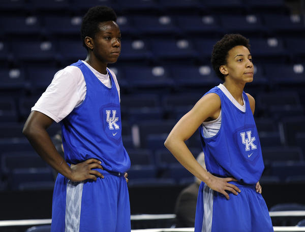 Kentucky's Samarie Walker, left, and Kastine Evans listen as head coach Matthew Mitchell gives instruction during practice at the TD Bank Arena at Harbor Yard in Bridgeport.