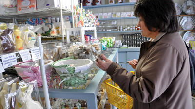 Cindy Brant of Somerset tries to decide what candy to purchase at Henrys Cake and Candy Supplies in Friedens. Brant said she likes peanut butter meltaways and chocolate-covered pretzels.