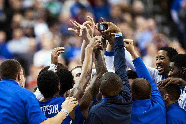 Florida Gulf Coast Eagles celebrate March 24 after defeating the San Diego State Aztecs during the third round of the NCAA basketball tournament at Wells Fargo Center in Philadelphia.