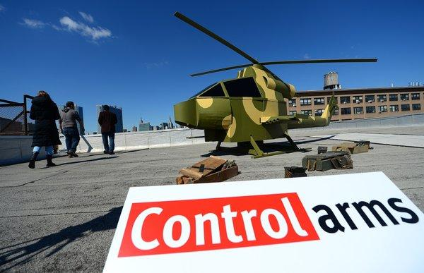 A mock military helicopter sits on a New York rooftop during a campaign by activists with the Control Arms Coalition.