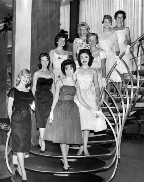 Nine candidates for the 1961 Miss Glendale contest paraded down the steps of the Fidelity Federal Savings & Loan. From the top: Chrysilla Smith, Joan Olson, Jaynee Paul, Terri Krieger, Merry Ridge, Pam Petersen, Juliann Smith (Budimir), Carolyn Castoe and Sally Ann Martin.