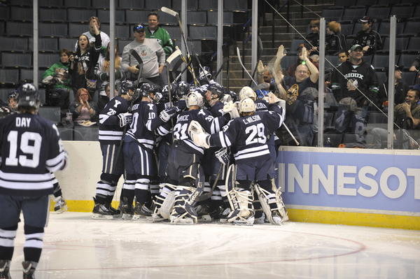 Yale celebrates a victory over top-seeded Minnesota in the NCAA West Regional semifinals Friday in Grand Rapids, Mich.