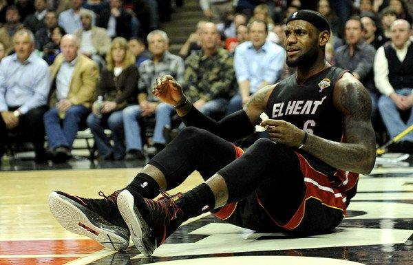 Miami Heat forward LeBron James falls to the court after getting fouled during a 101-97 loss to the Chicago Bulls on Wednesday.