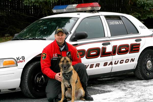 K-9 officer Keith Bredbenner of the Lower Saucon Police Department with Brutus. They are both graduates of the Progressive K-9 Academy.