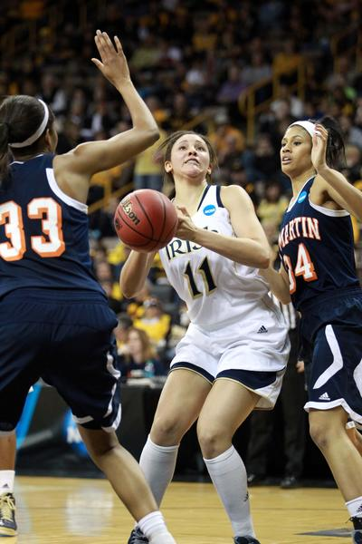 Notre Dame's Natalie Achonwa is defended by Tennessee-Martin's Rickiesha Bryant and Shelby Crawford.