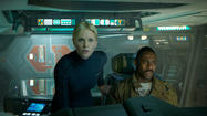 "Charlize Theron and Idris Elba in the movie ""Prometheus."" Elba portrays Nelson Mandela in the upcoming biopic ""Mandela: Long Walk to Freedom."""