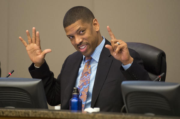 Sacramento Mayor Kevin Johnson counts the votes in favor of a new arena during a City Council meeting at City Hall on March 26.