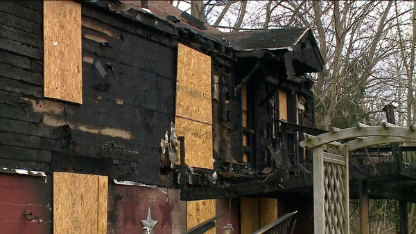 A fire on Wednesday destroyed the home of family whose children survived the shooting Dec. 14 at Sandy Hook Elementary School. Bill Halstead, Newtown's fire marshal and the chief of the Sandy Hook Volunteer Fire and Rescue Co., said Friday that the fire at 254 Berkshire Road began in the basement and burned into the first floor, heavily damaging the home.
