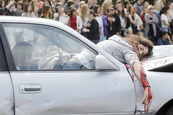 Huntington Beach High School, with the help of M.A.D.D., stages a fake DUI crash during an Every 15 Minutes assembly to educate students about the risks of drunk driving on Wednesday.