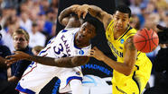 ARLINGTON, Texas -- Trey Burke scored all 23 of his points after halftime, including a long, tying 3-pointer in the final seconds of regulation, and Michigan rallied to beat Kansas 87-85 in the South Regional semifinals Friday night.