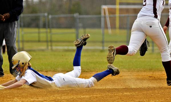 Jonathon Gruenke/Daily Press Photo Smithfield's Allie Nowak, left, dives into second base underneath Poquoson's Logan Walker during Friday's game.