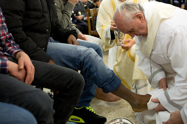 Pope Francis washes the foot of an inmate at the juvenile detention center of Casal del Marmo in Rome.