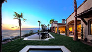 "This Spanish-style contemporary sits on a bluff overlooking a Malibu surfing beach. The single-story house is in <a href=""http://www.marisolmalibu.com/en/"" target=""_self"">MariSol</a>, an 80-acre community of 17 estates."