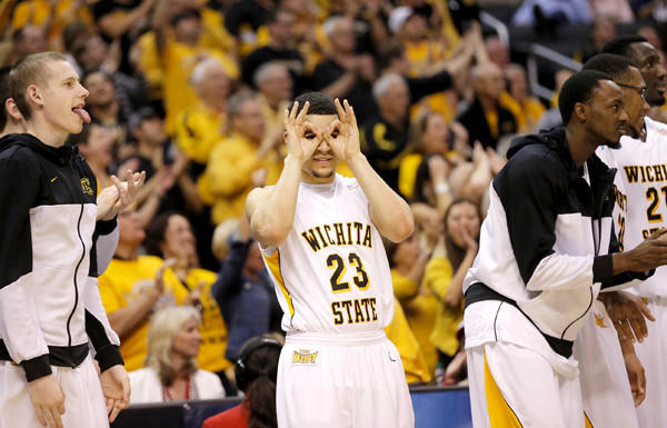 Wichita State guard Fred Van Vleet (23) gives the three-point sign after a teammate's long-range basket against La Salle in the second half of a West Regional semifinal game Thursday night at Staples Center.