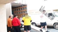 The Estancia High School football program helped an alumna move this month.