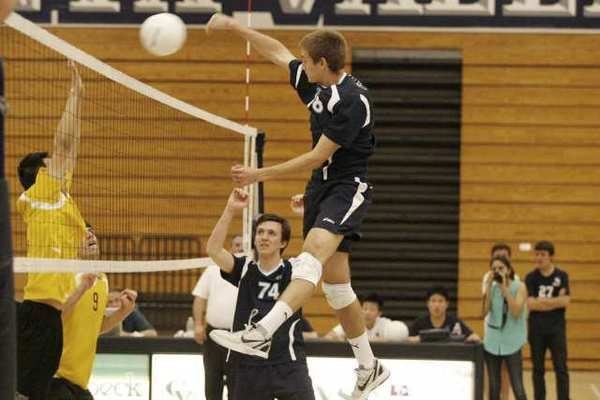 Crescenta Valley High's Freedom Tripp, right, goes for a kill in a five-game win over Pacific League opponent Arcadia High.