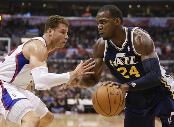 Clippers forward Blake Griffin defends Utah Jazz forward Paul Millsap. Milsap and the Jazz have the edge on the Lakers in the playoff race.