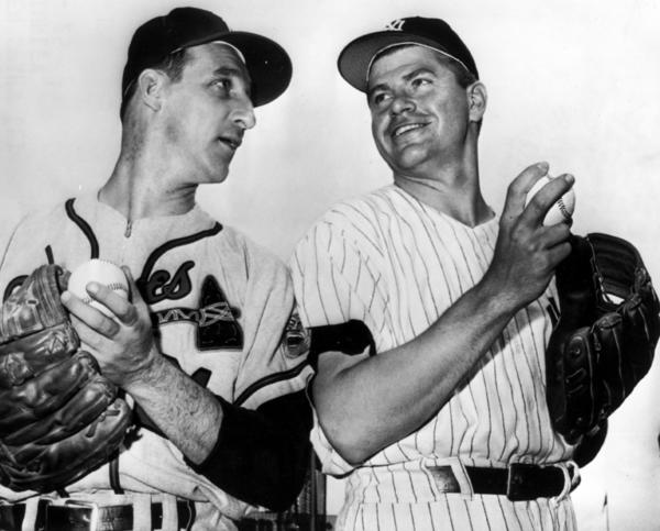 Warren Spahn of the Milwaukee Braves, left, starting pitcher for the national league, and his rival on the mound, Bob Turley of the New York Yankees in the American League, pose together before the start of the 1958 All-Star game