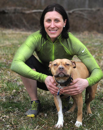 Andrea Monroe poses with her dog, Alba, at Loch Raven Reservoir.