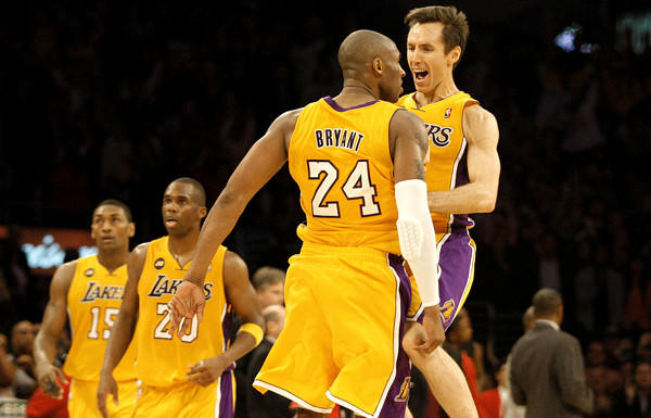 Kobe Bryant and Steve Nash, celebrating a Bryant dunk against the Raptors earlier this season, will try to overcome injuries to play Saturday night against Sacramento.
