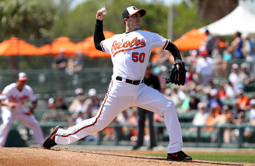 Miguel Gonzalez pitches against the Mets in the Orioles' final game of spring training.