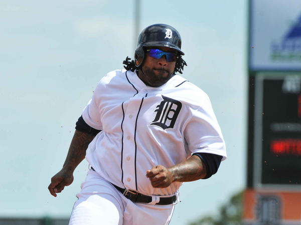 Detroit's Prince Fielder rounds third base and scores against the Nationals.