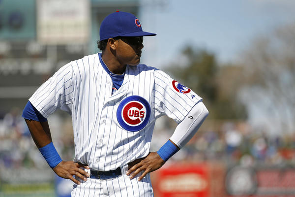 Starlin Castro warms up prior to a game against the Giants in a Cactus League game at HoHoKam Park.