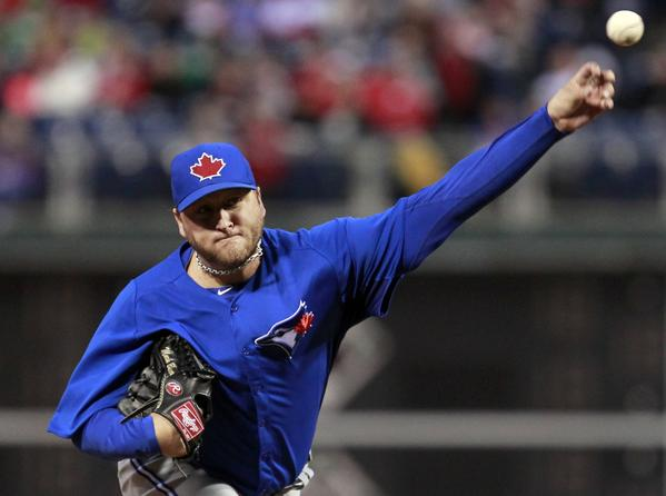 Blue Jays starting pitcher Mark Buehrle delivers a pitch to the Phillies.