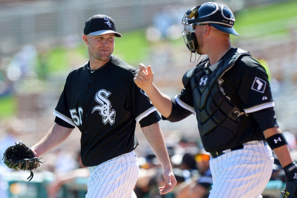 Sox starting pitcher John Danks and catcher Tyler Flowers talk as they take the field during the second inning against the Giants.