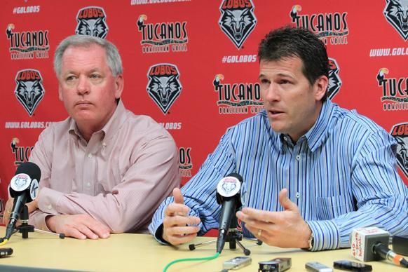 Steve Alford, with New Mexico Athletic Director Paul Krebs at his right, addresses the media after accepting the UCLA coaching job.