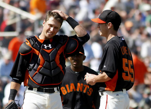 Giants catcher Buster Posey with starting pitcher Tim Lincecum.