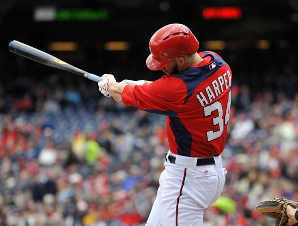 Nationals' Bryce Harper singles in the first inning against the Yankees.