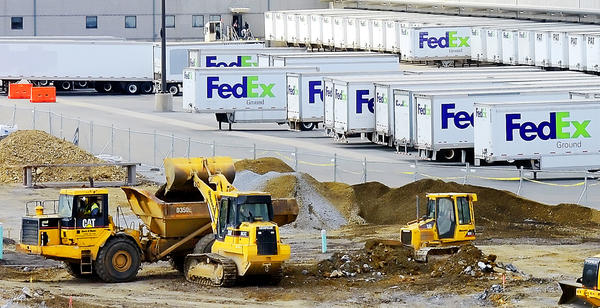Dirt is moved at the site of the new expansion being built on the grounds of the FedEx Ground package distribution center near Hagerstown.