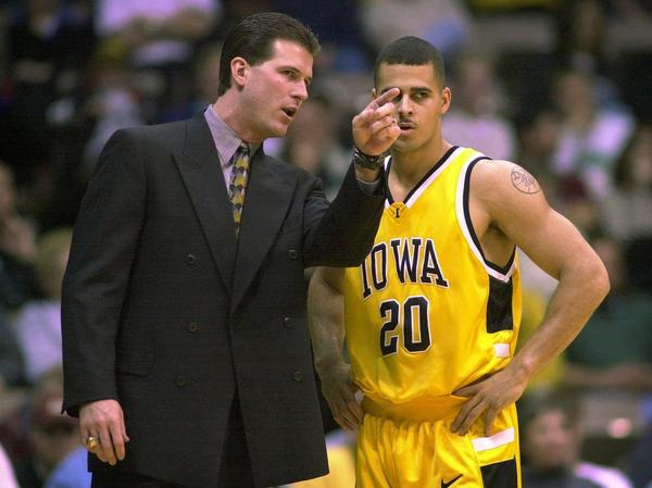 Steve Alford, as coach of Iowa in 2006, talks to guard Dean Oliver during a game. Alford led Iowa to a 25-9 record that year, including the Hawkeyes' second Big Ten Conference tournament championship.