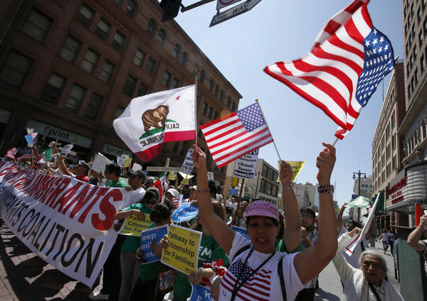 Several hundred people marched in downtown Los Angeles in support of comprehensive immigration reform.