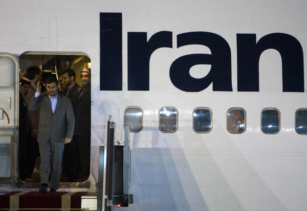 Iranian President Mahmoud Ahmadinejad waves to Iranian officials at the International Mehrabad Airport in Tehran after a trip to the U.N. in 2009.