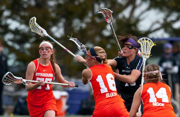 Ali Cassera scoring one of her five goals as the Northwestern women's lacrosse team beat Syracuse 13-12.